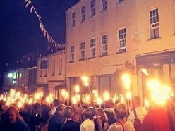 Busy torchlight procession closes windy Alderney Week
