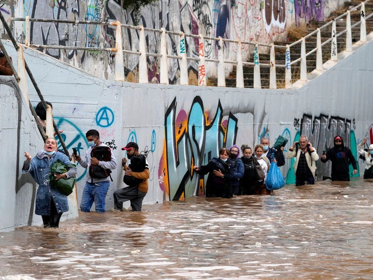 Homes flooded as storms batter Athens and fire-hit Greek island