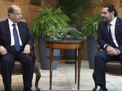 Lebanese PM puts resignation on hold after president asks him to reconsider