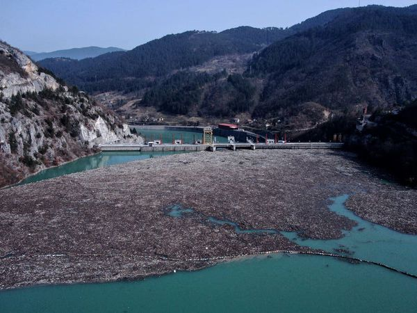 Rubbish fills Bosnia river faster than workers can pull it out