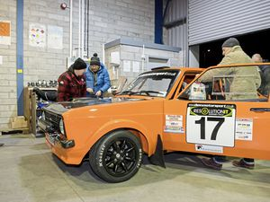 On the ball all weekend: Scrutineering for the inaugural Resolution IT Guernsey Rally took place on Friday evening at HR Air Freight. Driver Matthew Leggatt and navigator Gary Toy have their Ford Escort Mk2 given the once over. (Picture by Andrew Le Poidevin, 20752222)