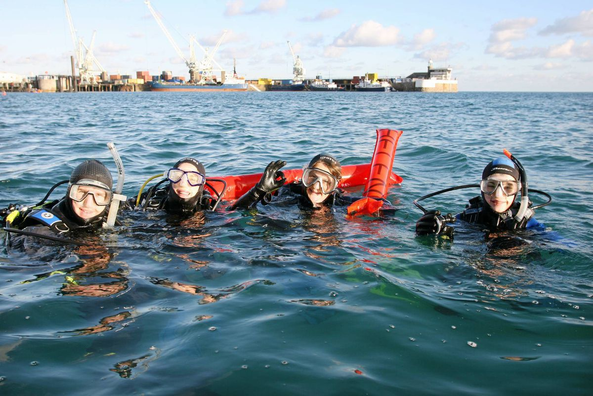 Donkey Divers in 2009 in St Peter Port Harbour on Christmas Day. Picture by Adrian Miller. (29055825)