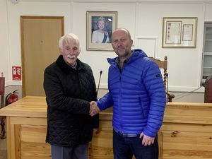 A historic handshake in Sark's Seneschal's Court between Edric Baker, left, who became the first person to sell part of a Sark tenement to his tenant, Marcus Barker.