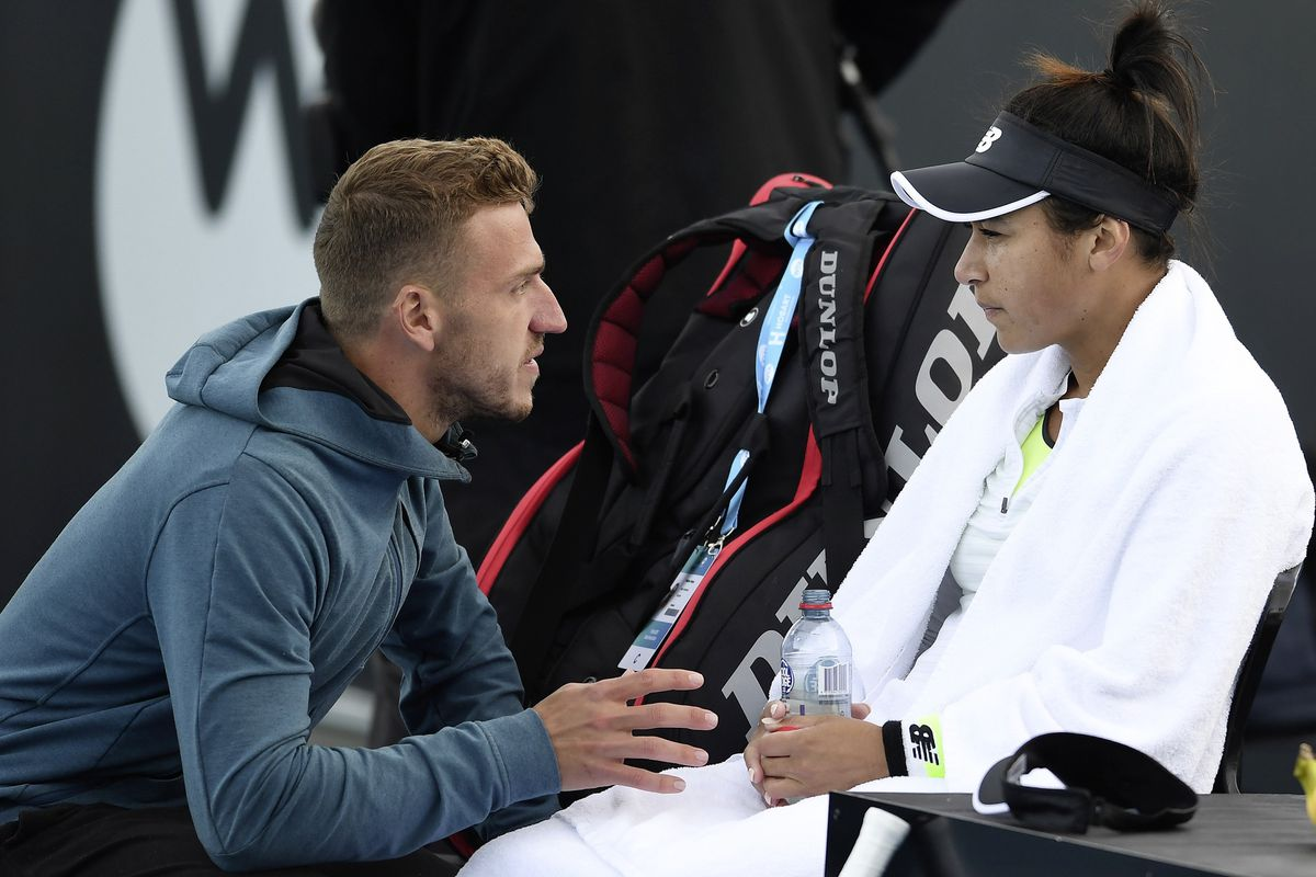 Listening in: Heather Watson talks with her coach in yesterday's semi-final clash against Elena Rybakina of Kazakhstan at the Domain Tennis Centre, Hobart.