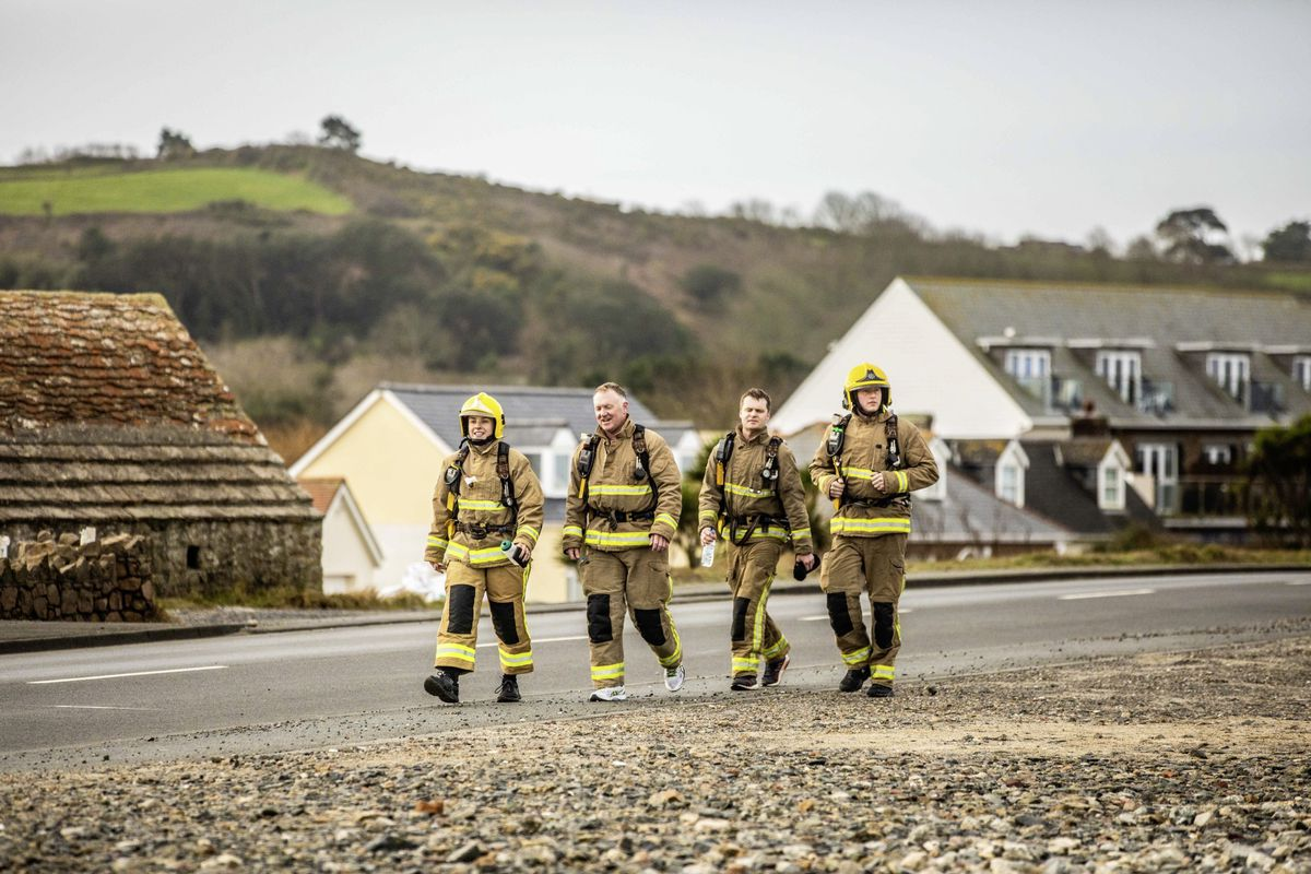 Tyler Thorne was delighted with the support she received from the Guernsey Fire & rescue Service for her charity walk for victims of the Australian bushfires, but was surprised when three firefighters joined her on the walk from Portelet to Town. (Picture by Ben Fiore, 27184952)