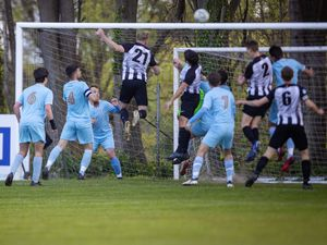 St Martin's Ben Coulter (No. 21) rises highest at a corner but cannot keep his header down in their goalless draw against North. (Picture by Sophie Rabey, 29467830)