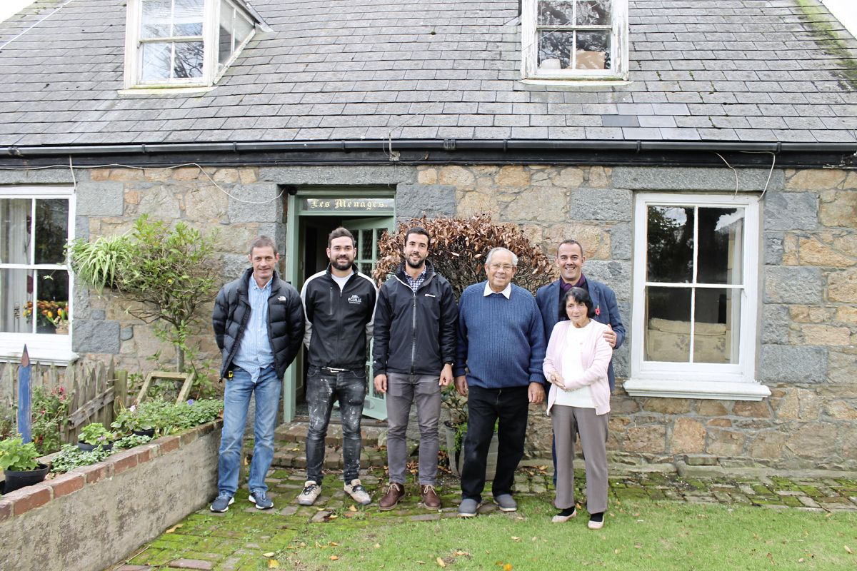 DIY SOS: Bert Fallaize and his wife Brenda with Andre Bisson (on the right) and three of the team who worked on Bert's  house.