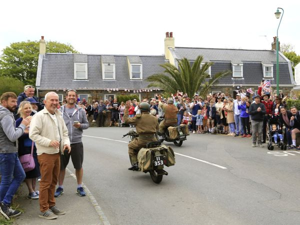 Islanders enjoying the cavalcade at the Last Post in St Andrew's (Picture by Adrian Miller, 29529142)