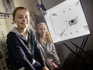 Pic supplied by Andrew Le Poidevin: 21-08-2021. Guernsey Museums Creative Castle event at Castle Cornet. Rory, 10, and Esther Tolcher, 7, had enjoyed trying out the camera obscura that had been set up in the clock tower. (29907416)