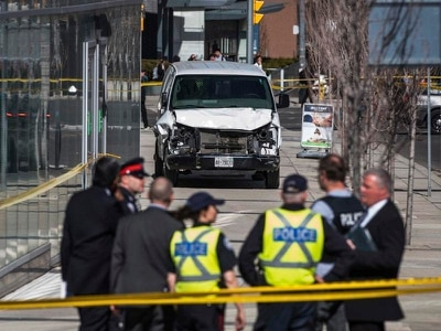 Toronto van attack suspect quizzed by police seeking driver's motive