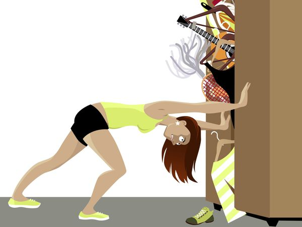 Wardrobe is bursting from stuff, woman trying to hold the doors closed, EPS 8 vector illustration (29226536)