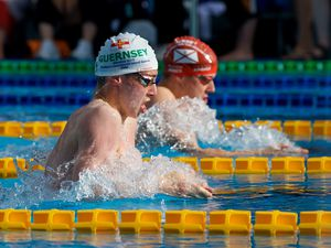 Breast to breast in Gibraltar: Big Channel Island rivals Charlie-James Hallett and Robert Jones push hard in the men's 200m breaststroke. Neither man will see much competitive action this calendar year.