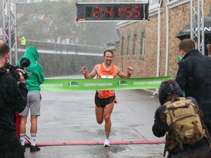 Pic by Adrian Miller 25-10-20 Guernsey Marathon 2020 Richard Friedrich at the finish line. (29257307)