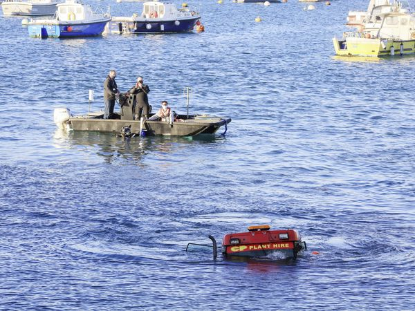 The CP Plant Hire tractor submerged after being unable to stop on the slipway by Boatworks+ with the States' divers ready to move in and help retrieve it. (Pictures by Adrian Miller, 29285663)