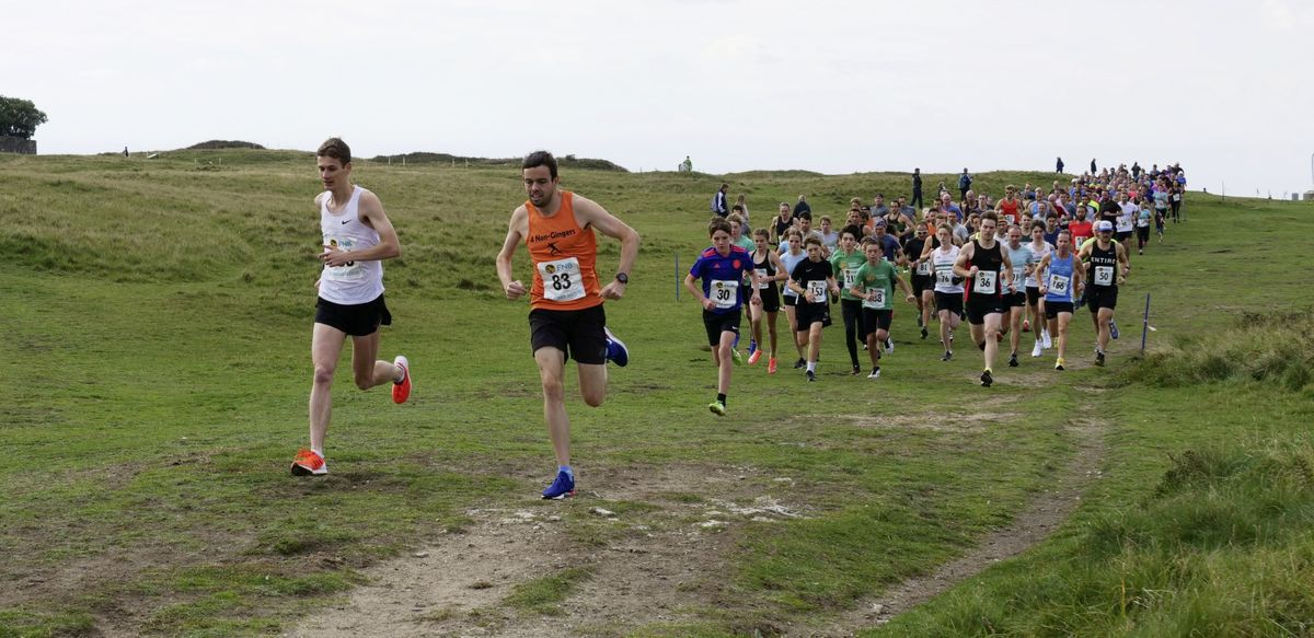 Eventual race winner James Priest (orange vest) and Sam Lesley lead the field at the start of the opening race of the new FNB Cross-Country Series. (Picture by Phil Nicolle,28811514)