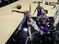 Spurs down Kings in overtime