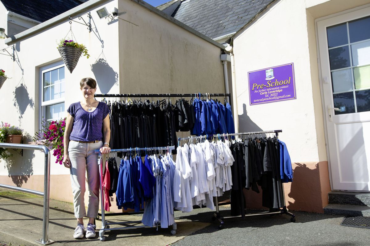 Alison Hamer at Torteval Pre-school with the second-hand uniforms she has put on sale for the fraction of the price of a new one. (Picture by Cassidy Jones, 29767537)