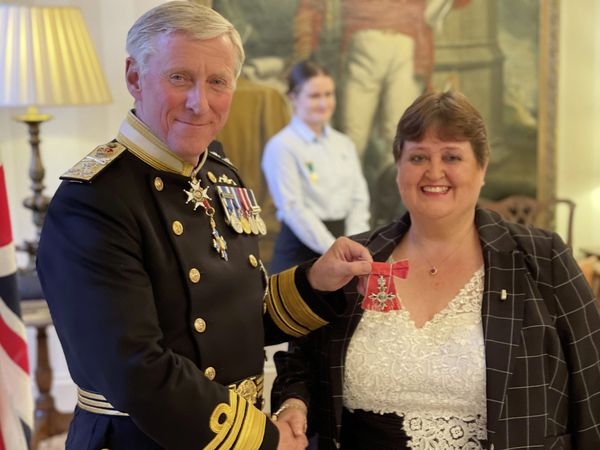 Dr Sue Fleming, the matron of St John's Residential Home, chose to receive the insignia of her MBE at Government House from Lt-Governor Vice Admiral Sir Ian Corder. (Picture supplied by Government House)