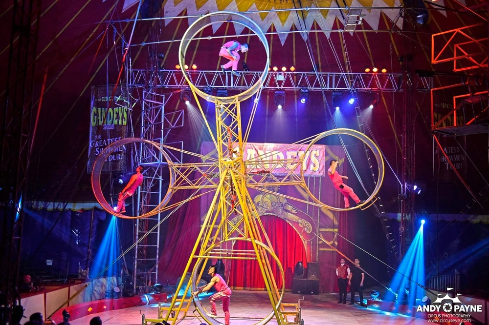 Circus artist escapes broken bones after wheel fall