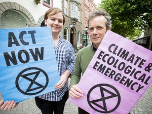 Extinction Rebellion campaigners William Carter, left, and Rob Gregson get their message across in Market Square.