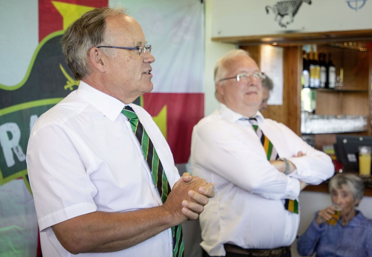 Raiders chairman Charles McHugh introduced former Bailiff Sir Richard Collas at Saturday's unveiling of the Guernsey Rugby Club's new mural. (Picture by Sophie Rabey, 28458067)