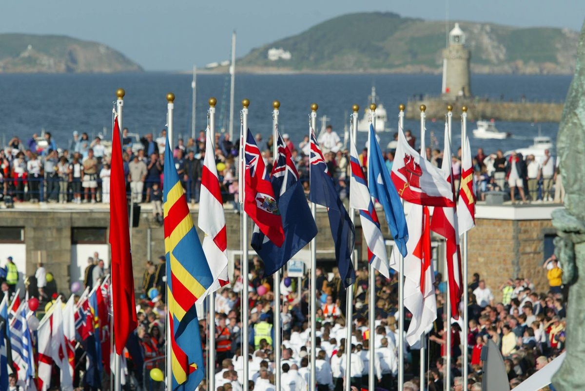Guernsey's harbour scene in 2003 when the flags of the participating islands added colour to the opening proceedings: Let's keep the flags flying even if a full-on Games is not possible in 2021. (28676695)