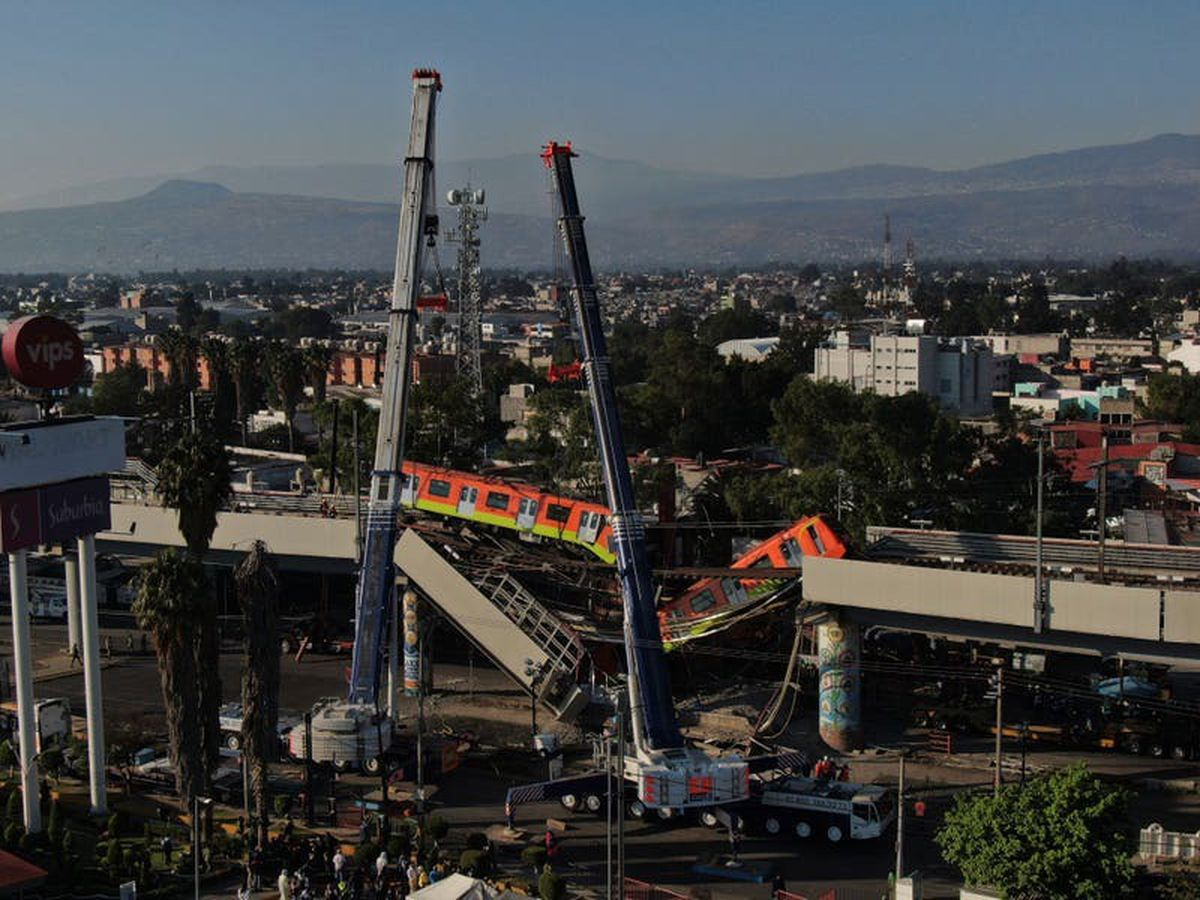 23 killed as metro overpass collapses on to road in Mexico City