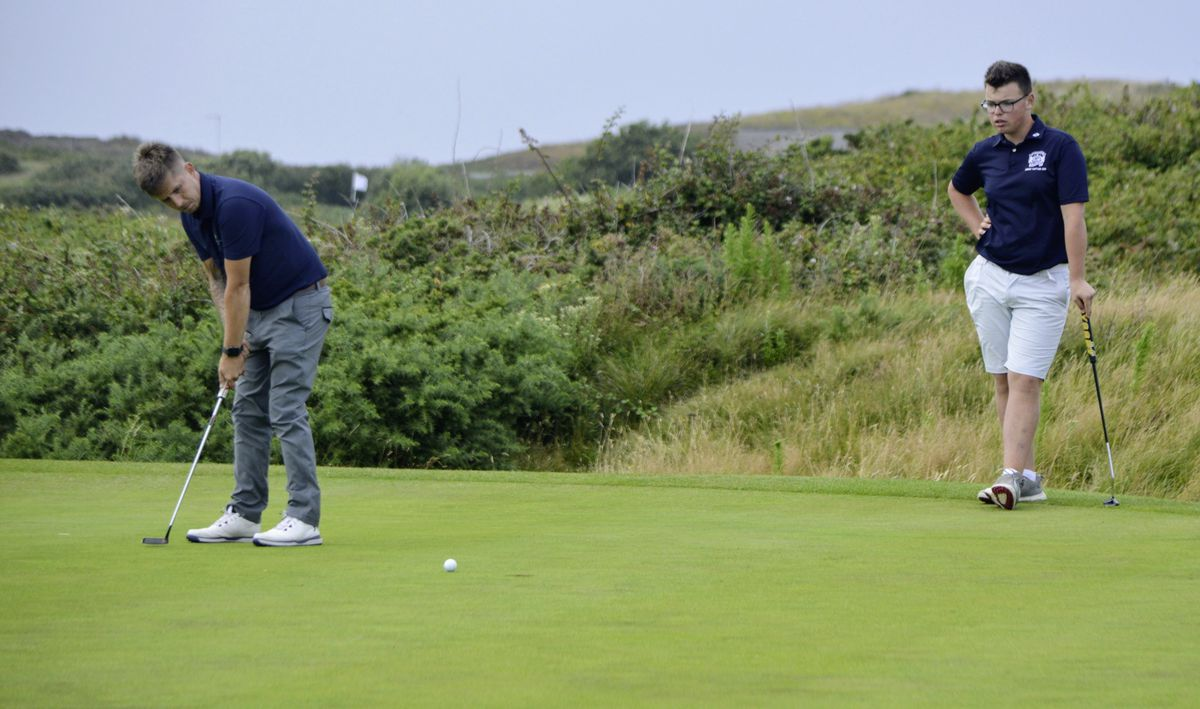 Ben Hibbins putts watched by playing partner Ollie Chedhomme. (Picture by Gareth Le Prevost, 28515257)