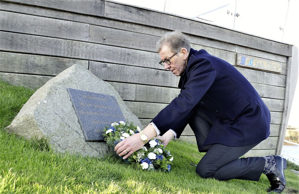 States President William Tate laid a wreath at the memorial stone at the harbour.