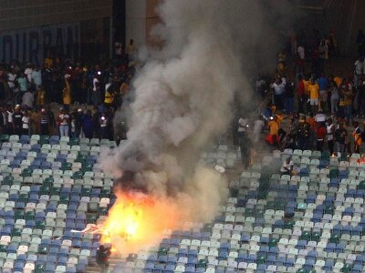 South African football league investigates after 18 hurt in stadium riot