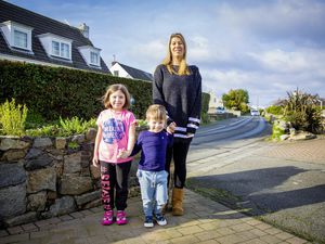 Michelle Mahy, pictured with children Scarlett, 7, and Jax, 3, said the amount of development being considered near Oatlands Lane, where she has lived all her life, was 'quite scary'. (Pictures by Sophie Rabey, 29096299)