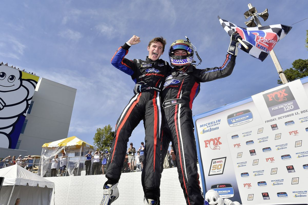 Seb Priaulx and Austin Cindric celebrate their win in victory lane at Road Atlanta. (Picture by LAT Images, 26063107)