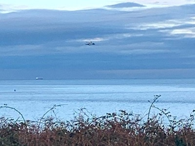 Body found in hunt for pilot after light plane crashes off coast