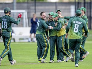 Guernsey celebrate David Hooper's direct hit run out of Anique Uddin. (Picture by Martin Gray, 25007575)