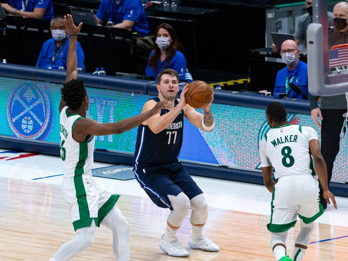 Luka Doncic's two late three-pointers propel Mavericks to victory over Celtics