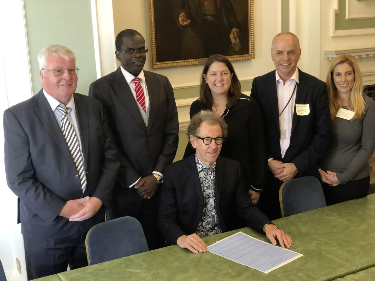 The signing of the charter. Left to right: John Young (Jersey), Claude Hogan (Montserrat), Billy Tate (Alderney), Stephanie Martin (Tristan da Cunha), Barry Brehaut (Guernsey) and Liesl Mesilio (Gibraltar). (Picture by Gregory Guida)