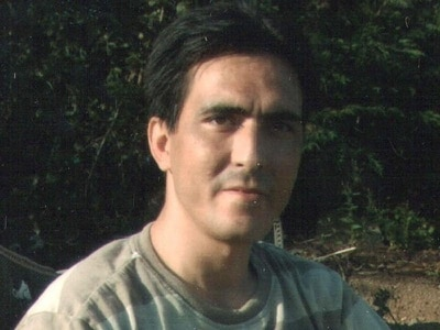 Report into Iranian man's murder finds 'evidence of institutional racism'