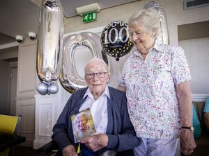 Picture By Sophie Rabey.  12-08-21.  Douglas Coxell turns 100 today and was enjoying a lunch at La Reunion, celebrating with his family before tea and cake back at Summerland House Care Home where he now lives.  With his wife Jan, he holds his card from The Queen. (29867571)