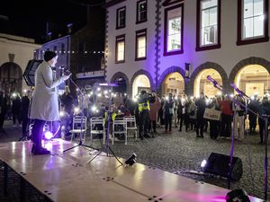 Pic supplied by Andrew Le Poidevin: 23-03-2021. People held their mobile phone lights during a vigil and peaceful protest for women affected by gender violence held at the Market Square, St Peter Port. (29369288)
