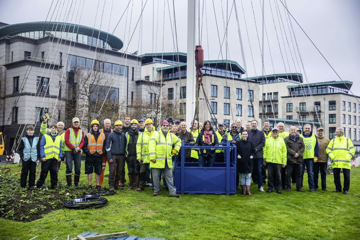 The Guernsey Rotary Club at the bottom of the Tree of Joy before Director of Public Health Dr Nicola Brink was lifted in a crane to place the star at the top. (Picture by Ben Fiore, 28938211)