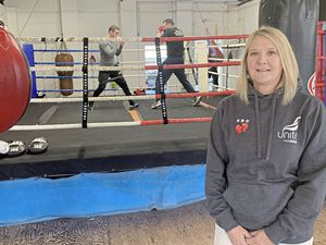 Mandy Wickenden, coach and fundraising co-ordinator at the Guernsey Amalgamated Boxing Club. Sparring in the background is Rory Jones, left, and Jimmy Lesbirel.                                       (Picture by Zoe Fitch, 229541340