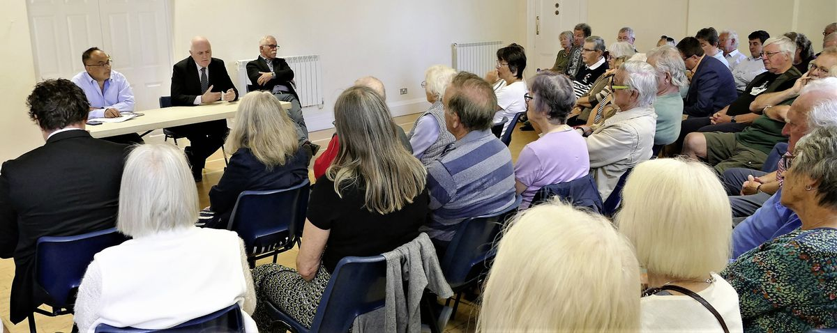 About 60 residents attended an open meeting with the two Guernsey politicians in the Island Hall.