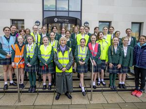 Living Streets Guernsey secretary Pat Wisher, centre, with students and teachers from Ladies' College, who were among those to receive free hi-vis vests from the road safety group.  (Picture by Sophie Rabey, 28950673)