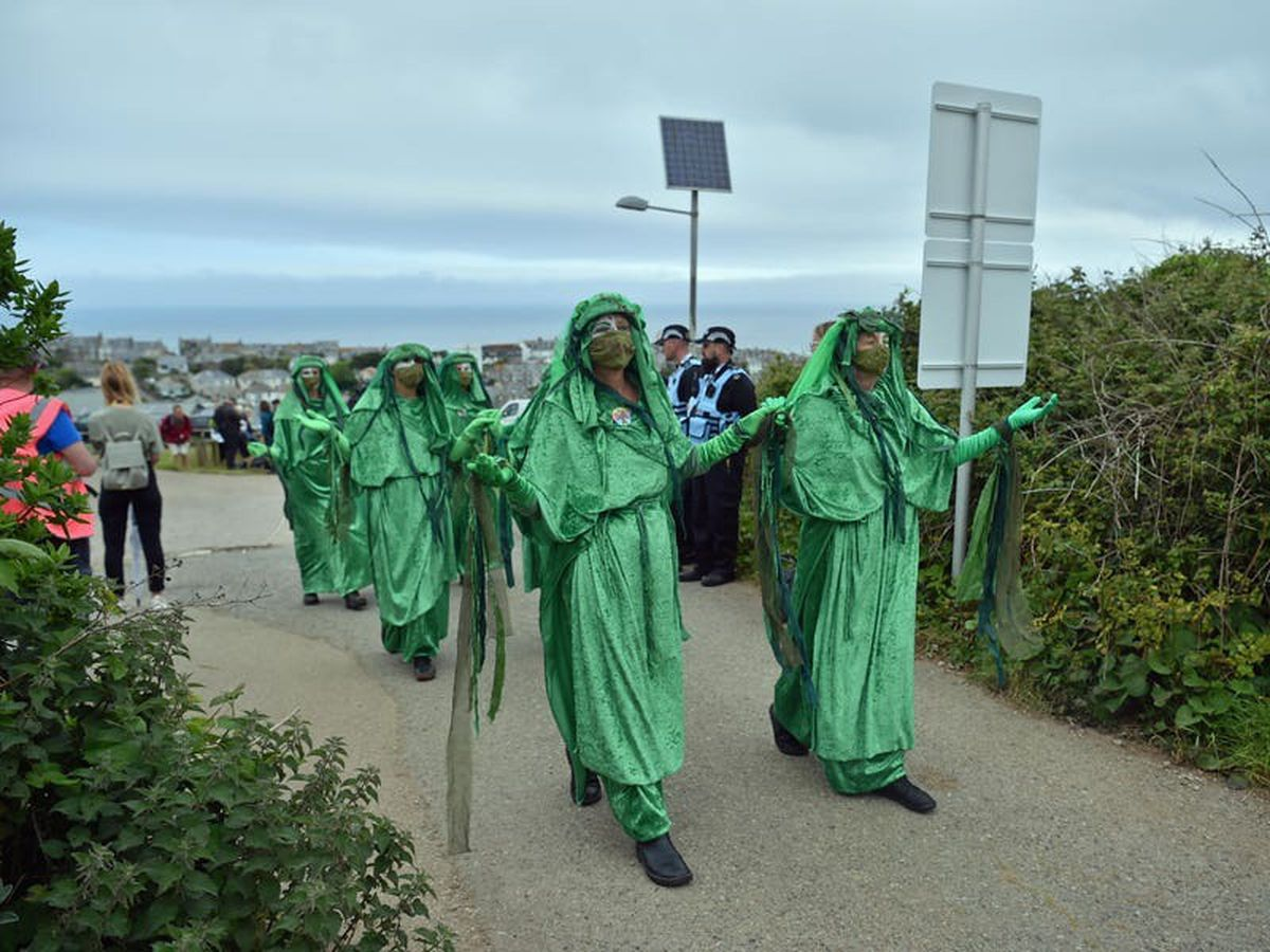 Hundreds of Extinction Rebellion protesters join march at G7 summit