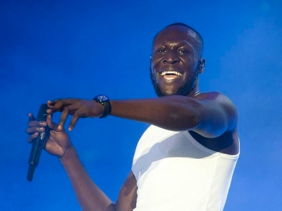 Stormzy helps decorate boy's bedroom as reward for good behaviour at school