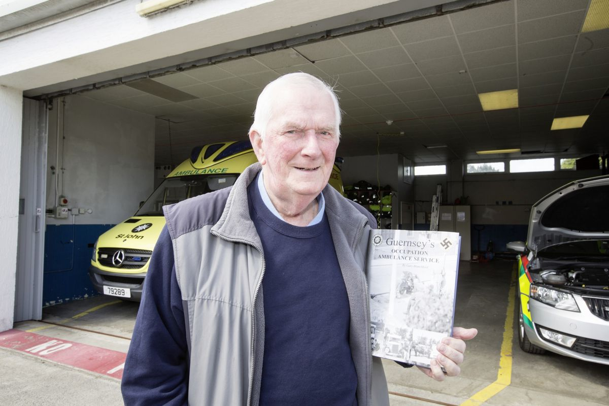 Gary Blanchford and his book of old photographs by his father Reginald Herbert Blanchford, of Guernsey's Occupation Ambulance Service. (Picture by Adrian Miller, 29513737)