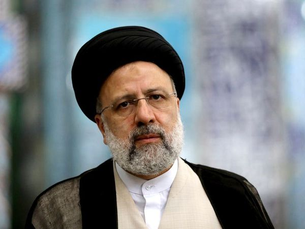 Iranians vote in presidential election tipped in favour of hard-liner