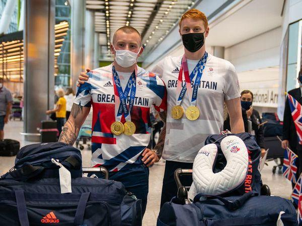 British swimmers arrive back in UK after medal success in Tokyo