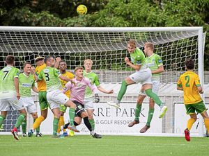 GFC striker Will Fazakerley heads clear from a Ashford United set piece.  (Picture by Andrew Le Poidevin, 22312327)