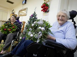 Guernsey Cheshire Home residents Rosie Le Maitre, left, and Angela Gaskill are among those who have been making Christmas wreaths to sell at its annual fayre, which will be held at the home for the first time.